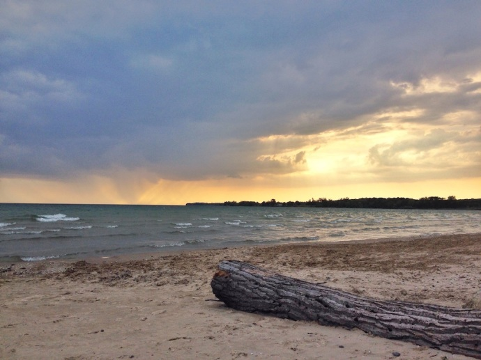 We watched the rain move across Lake Ontario in the near distance.