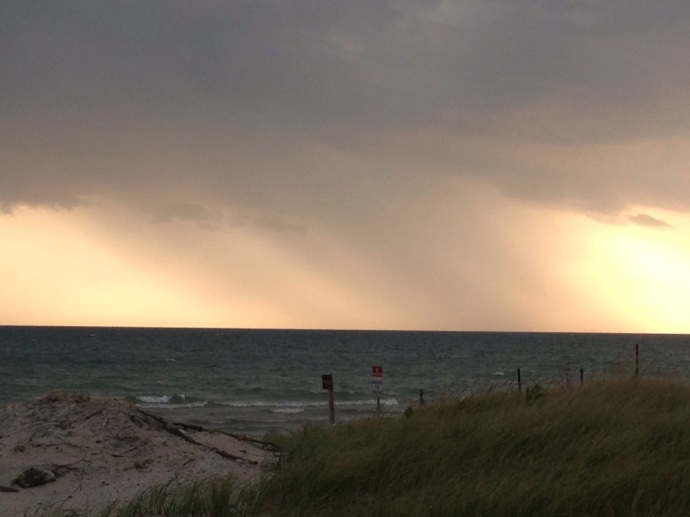 Watching the rain intensify as it moved across Lake Ontario in the near distance.